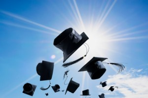 graduation-ceremony-graduation-caps-hat-thrown-air-with-blue-sky-abstract_43379-1344